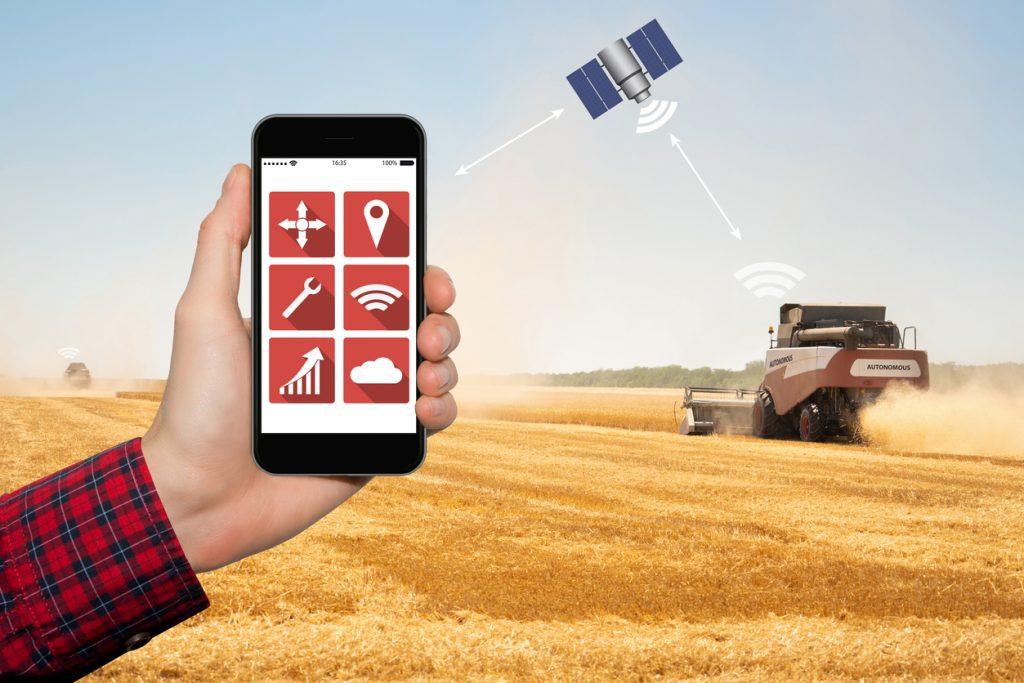 Farmer controls autonomous harvester